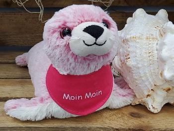 Plüschseehund mit pinken Glitteraugen und pinken Tuch