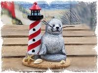 Seehund mit Leuchtturm ca.7x5x8cm